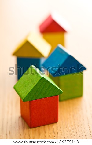 the houses made from wooden toy blocks - stock photo