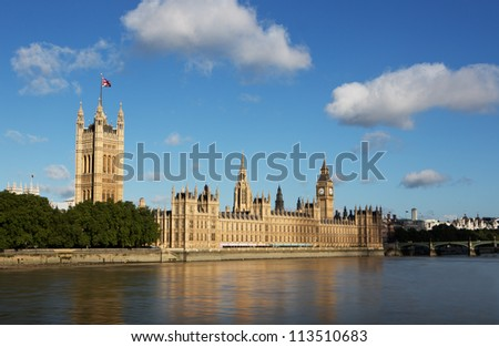 The Houses of Parliament with blue skies - stock photo