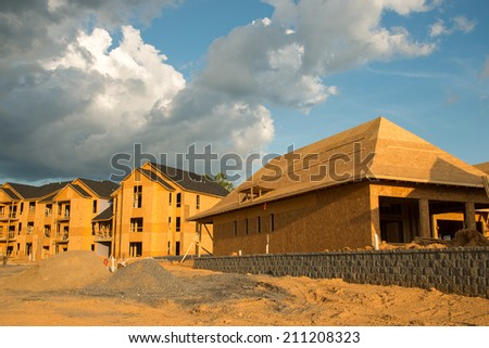 The housing market is increasing with the development of new houses and condominiums in rural areas as well as the suburbs. - stock photo