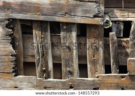 The hull of an old wooden boat hull Iceland,Old wooden ship hull texture - stock photo