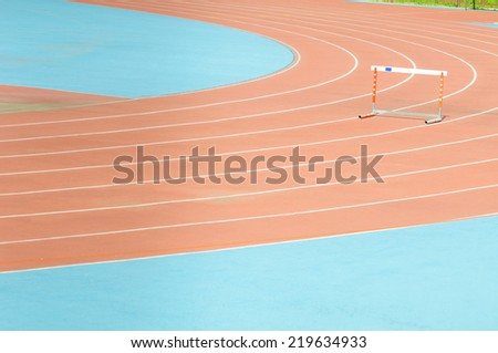 The hurdle on empty treadmill at stadium. - stock photo