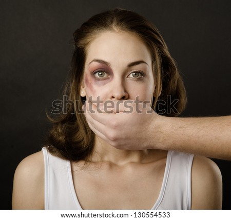 the husband makes the wife silent. on dark background - stock photo