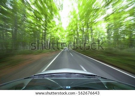 The hybrid car which runs in fresh green - stock photo