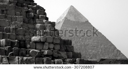 The iconic Great Pyramids of Giza, Egypt. The pyramids of Egypt are major tourist attraction and travel destination in Egypt. - stock photo