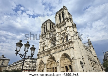 The iconic Notre Dame cathedral in Paris with dramatic clouds - stock photo