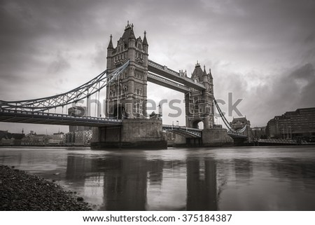 The iconic Tower Bridge in the morning - vintage version - London, UK - stock photo