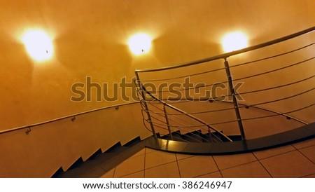 The idea of design of a spiral staircase in the suburban villa - stock photo