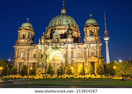 The illuminated Berliner Dom and the TV Tower at night - stock photo