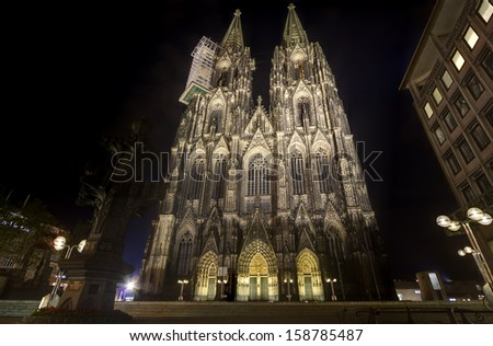 The illuminated Cologne Cathedral at night in Cologne, Germany - stock photo