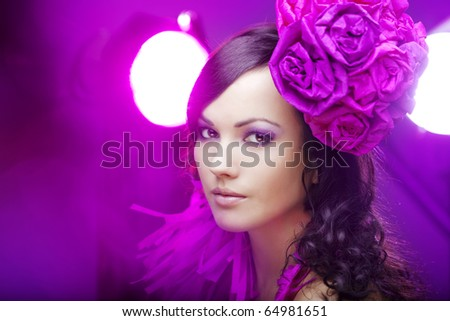 The image of a beautiful girl in a hat with roses - stock photo