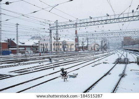 the image of a winter view of the railroad tracks - stock photo