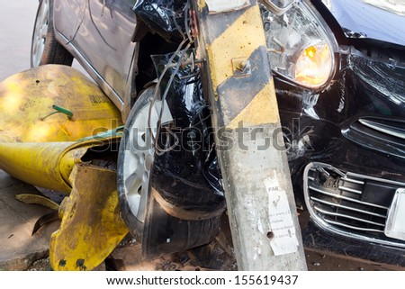 The image of car crashes into electricity pole - stock photo
