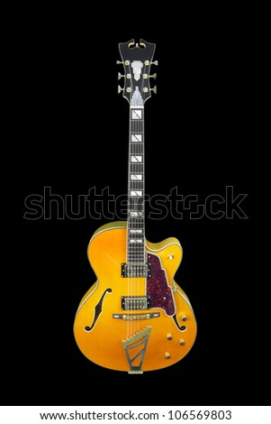 The image of guitar under the dark background - stock photo