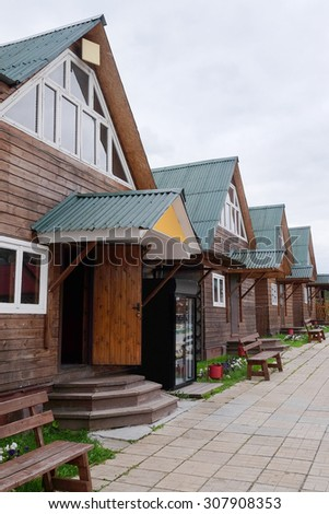 The image of log houses  - stock photo
