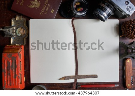 The image of open notebook with pen and the antique props. The vintage mood for writer or traveler. - stock photo