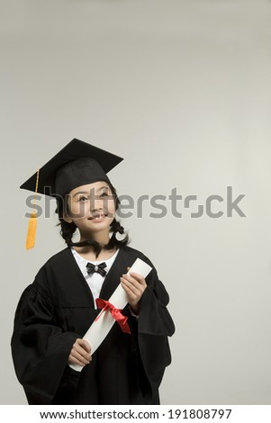 The image of smiling child graduating in Korea,Asia - stock photo