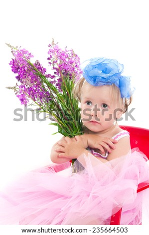 The image of the little girl with a willow-herb bouquet - stock photo