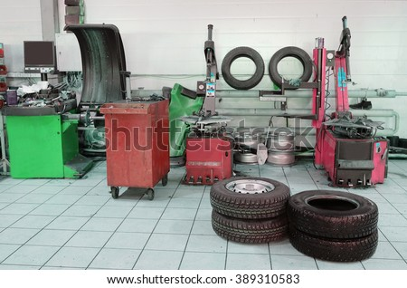 The image of tyre fitting machine - stock photo
