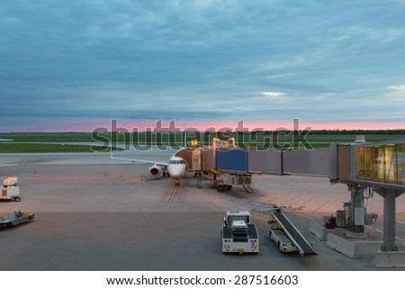 The image with an airfield aicraft boarding bridge - stock photo