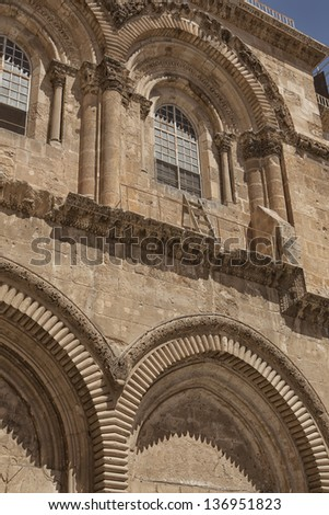 The immovable ladder on the Church of the Holy Sepulchre in the old city of Jerusalem - stock photo