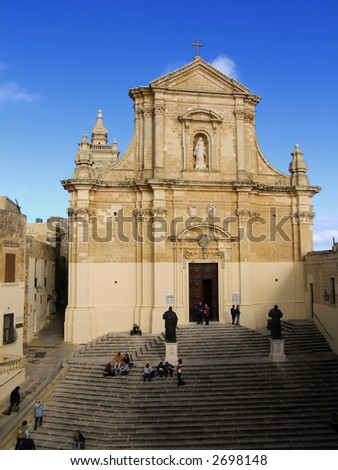 The imposing facade of the baroque cathedral in the Citadel on the Mediterranean island of Gozo - stock photo