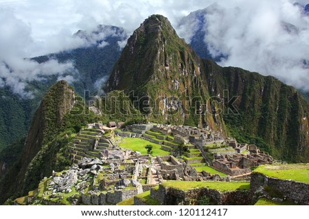 The Incan ruins of Machu Picchu in Peru - stock photo