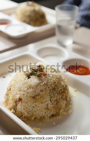 The Indian Pulav- biriyani It is a medley of rice, vegetables and/or meat. Basmati Rice. Yummy chicken biriyani Hyderabad India. - stock photo