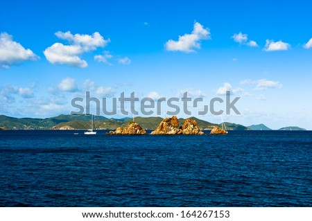 The Indians, a rock formation, off the coast of Norman island in the British Virgin Islands - stock photo