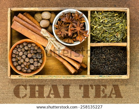 The ingredients for Chai tea in an antique cigar box with the words Chai Tea stenciled on the background - stock photo