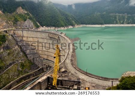 The Inguri Dam is a hydroelectric dam on the Inguri River in Georgia - stock photo