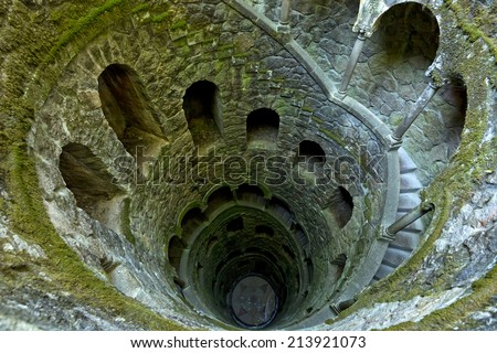 The Initiation well of Quinta da Regaleira in Sintra, Portugal. It's a 27 meter staircase that leads straight down underground and connects with other tunnels via underground walkways - stock photo