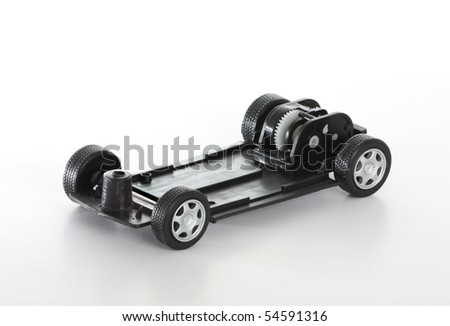 The inner mechanical parts of a dismantled toy car. - stock photo