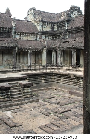 The inner stone courtyard on the upper level of Angkor Wat in Siem Reap, Cambodia - stock photo
