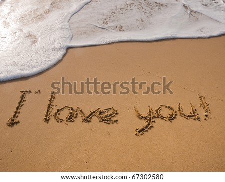 The inscription on the sand near the sea and the waves - I love you. Background. - stock photo