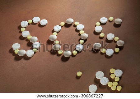 the inscription sos written tablets - stock photo