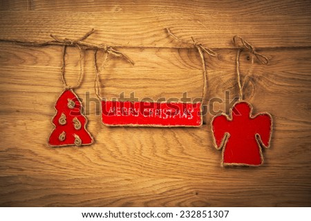 the inscription with Christmas on wooden background with Christmas tree and angel - stock photo