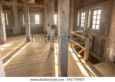 The insideof the wooden tower of a church with massive beams and thick timber. Windows are offering a great view. - stock photo