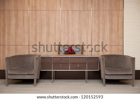 The interior design with brown sofa and red roses - stock photo