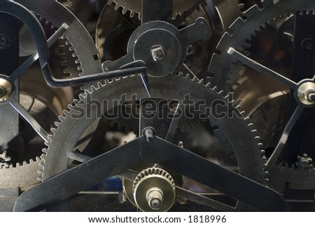 The interior gears and timing mechanism of an antique printing press - stock photo
