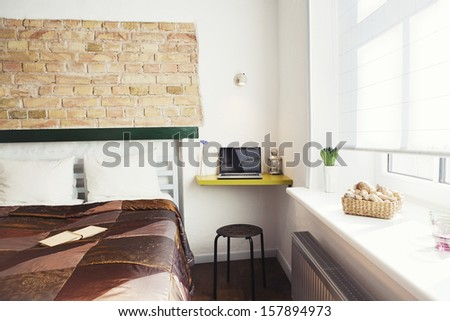 The interior of a cozy studio-type guest house - stock photo
