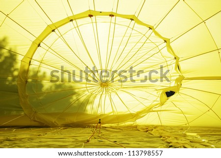 The interior of a yellow hot air balloon - stock photo