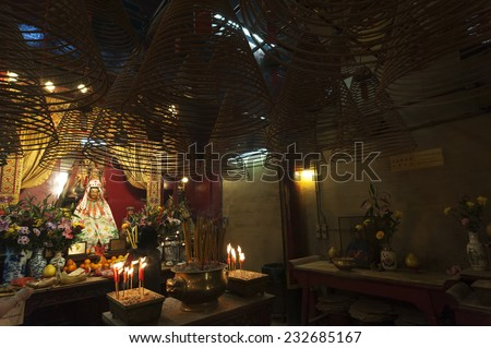 The interior of the Man Mo Temple, Hong Kong, with incense offer - stock photo