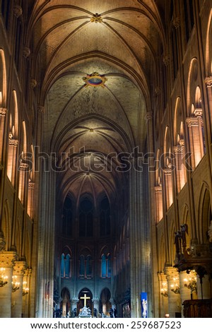 The interior of the Notre Dame de Paris at night, France  - stock photo