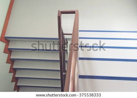 The Interior, staircase in house with brown metal banister - stock photo