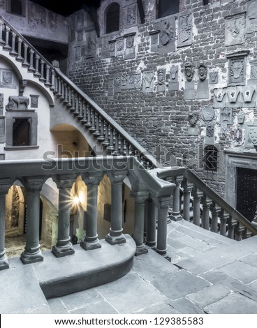 The interior with the great stairs of a medieval castle in Italy. The building is in the public domain - stock photo