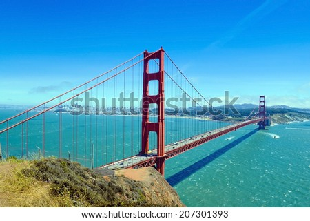 The international red Golden Gate Bridge from the north side of the bay looking into San Francisco. - stock photo