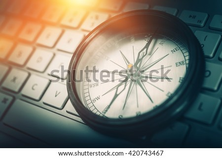 The Internet Navigator Concept Photo. Vintage Metallic Compass on the Computer Keyboard. Navigation Through the Internet. - stock photo