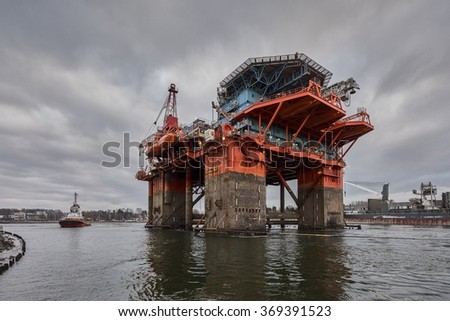 The introduction of a drilling rig to a shipyard for repairs, Oil rig - stock photo