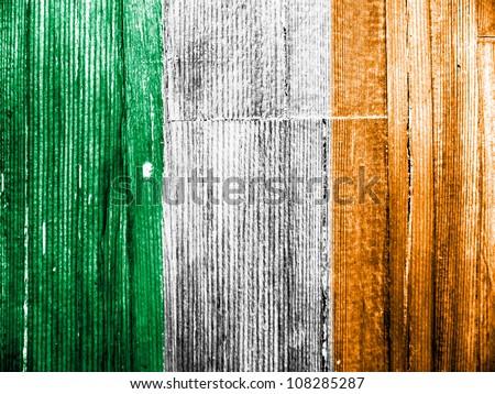 The irish flag painted on wooden pad - stock photo