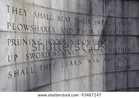 The Isaiah Wall in the Ralph Bunche Park at the United Nations, New York, USA. - stock photo